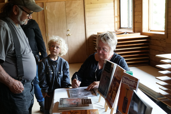 Judith Williams signing her book, Raincoast Chronicles 24: Cougar Companions.